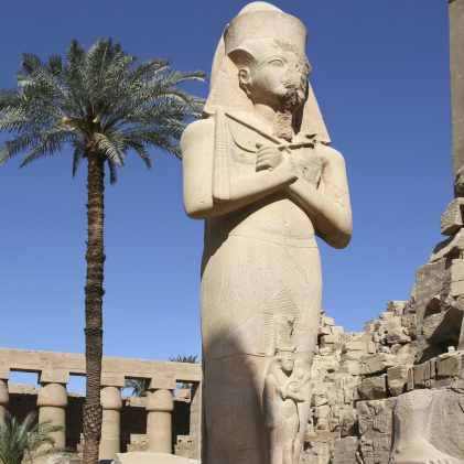 Statue of Ramesses II with folding arms in Karnak temple in Luxor, Egypt