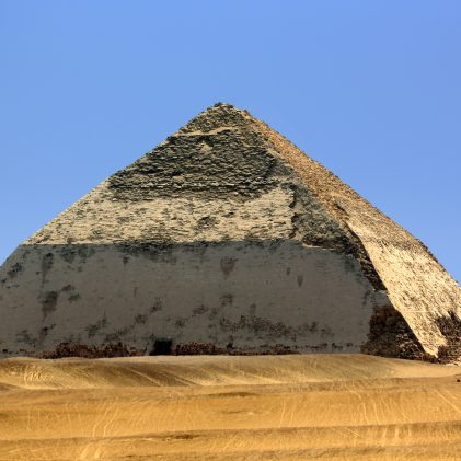 """Egypt. Dahshur (or Dashur). The Bent Pyramid (also knew as False, or Rhomboidal Pyramid because of it changed angle slope) of Pharaoh Sneferu with well preserved original limestone casing. The Pyramid Fields from Giza to Dahshur is on UNESCO World Heritage List since 1979"""